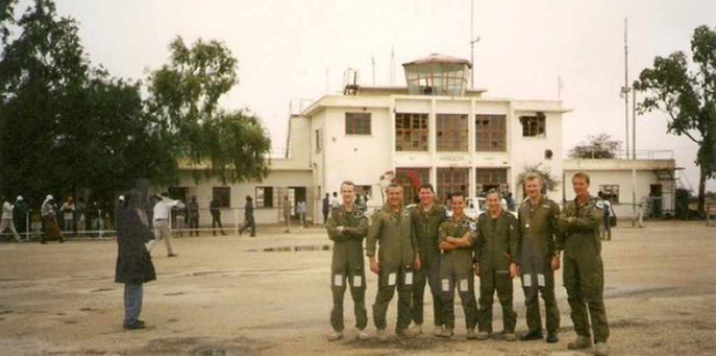 South African and Rhodesian pilots pose in front of Hargeisa terminal in 1988 after a killing sortie
